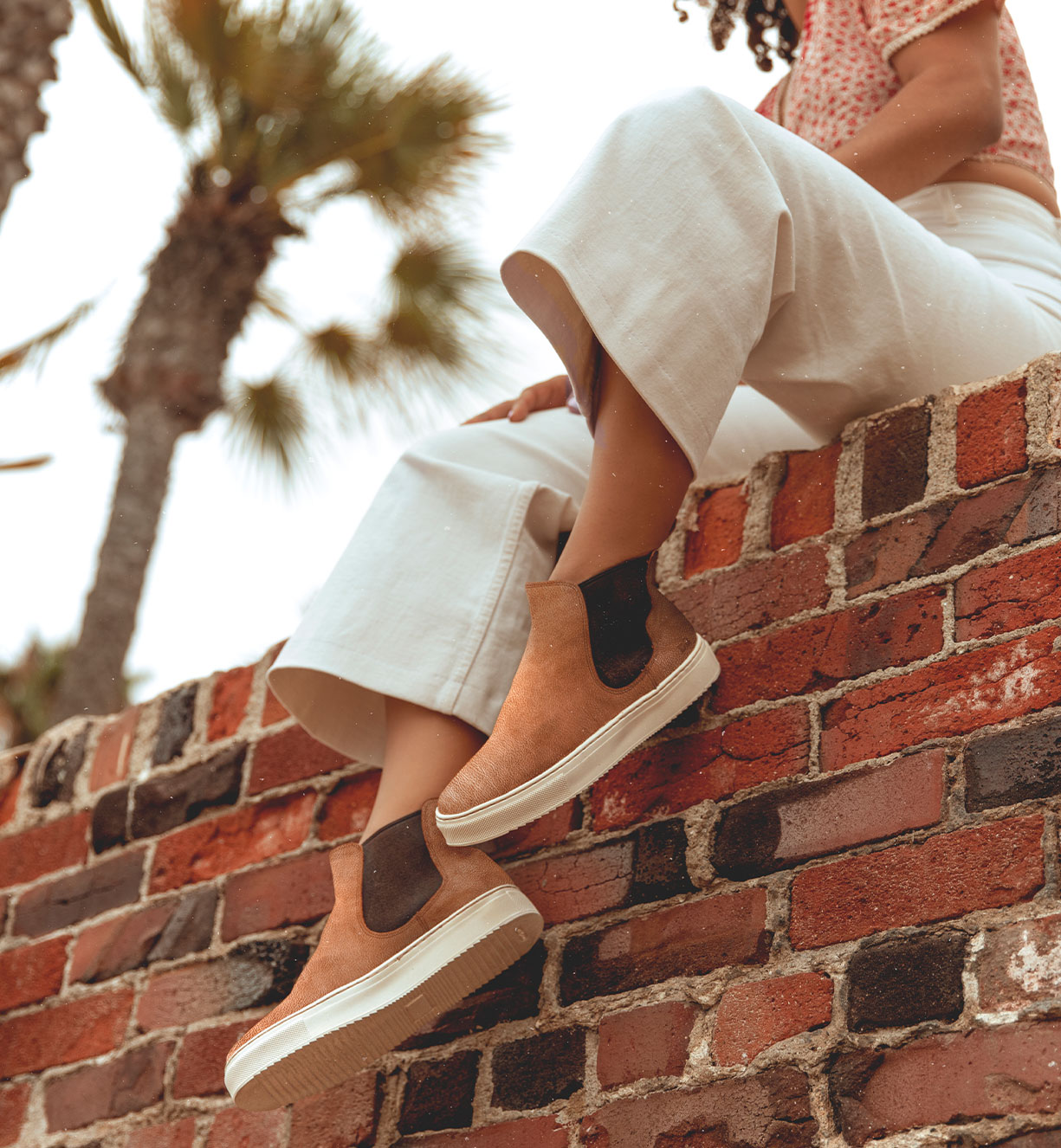 Woman is wearing sneaker boots in tan color