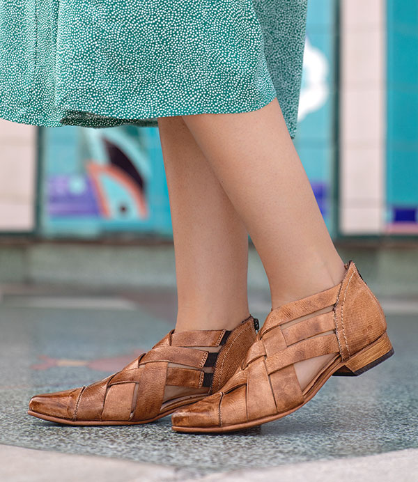 women is wearing leather shoes for spring days
