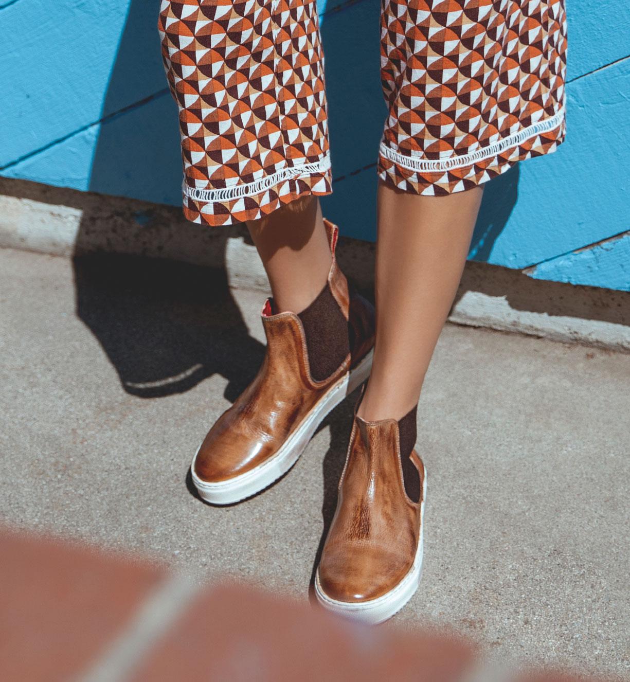 women's wearing tan color sneaker boots