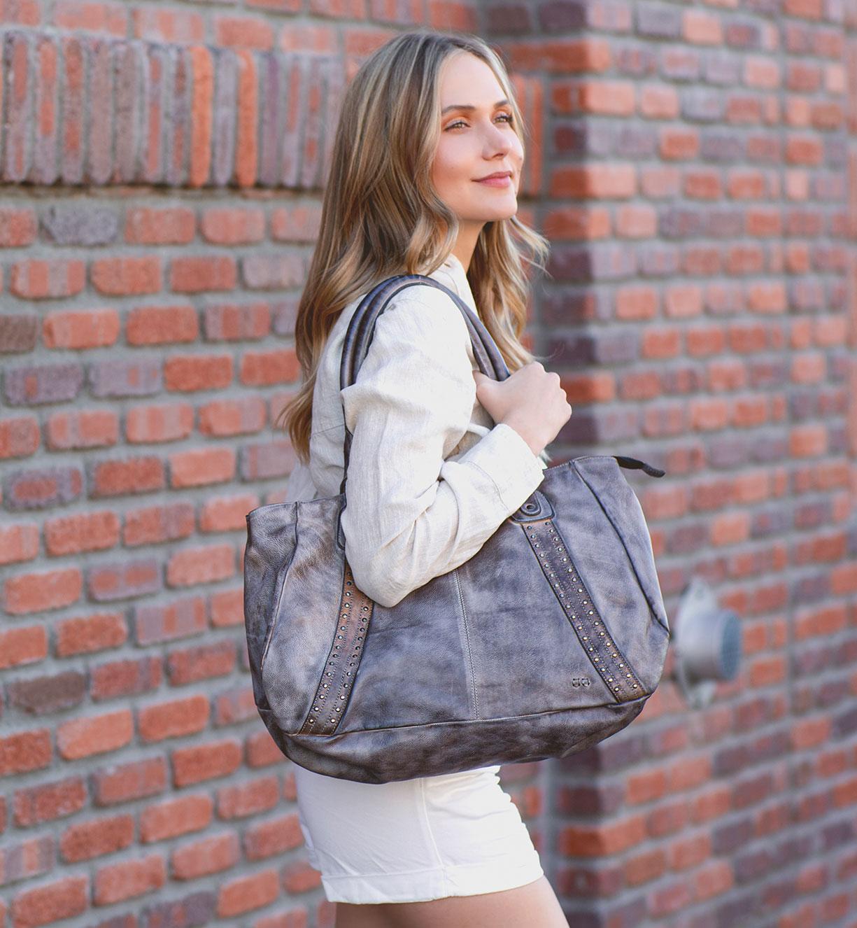 woman is showing over the shoulder bedstu leather handbag