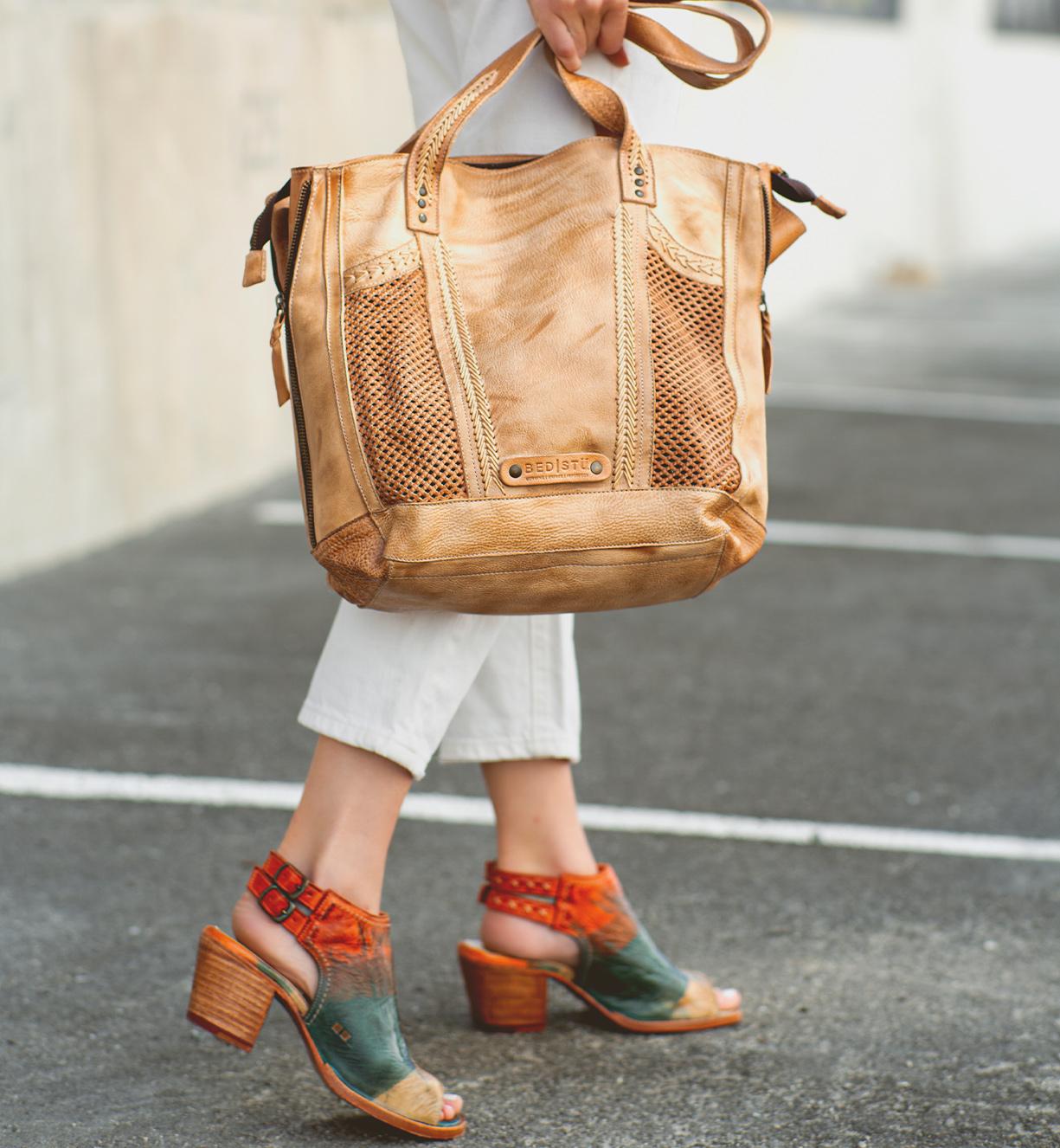 Woman's arm holding a handbag