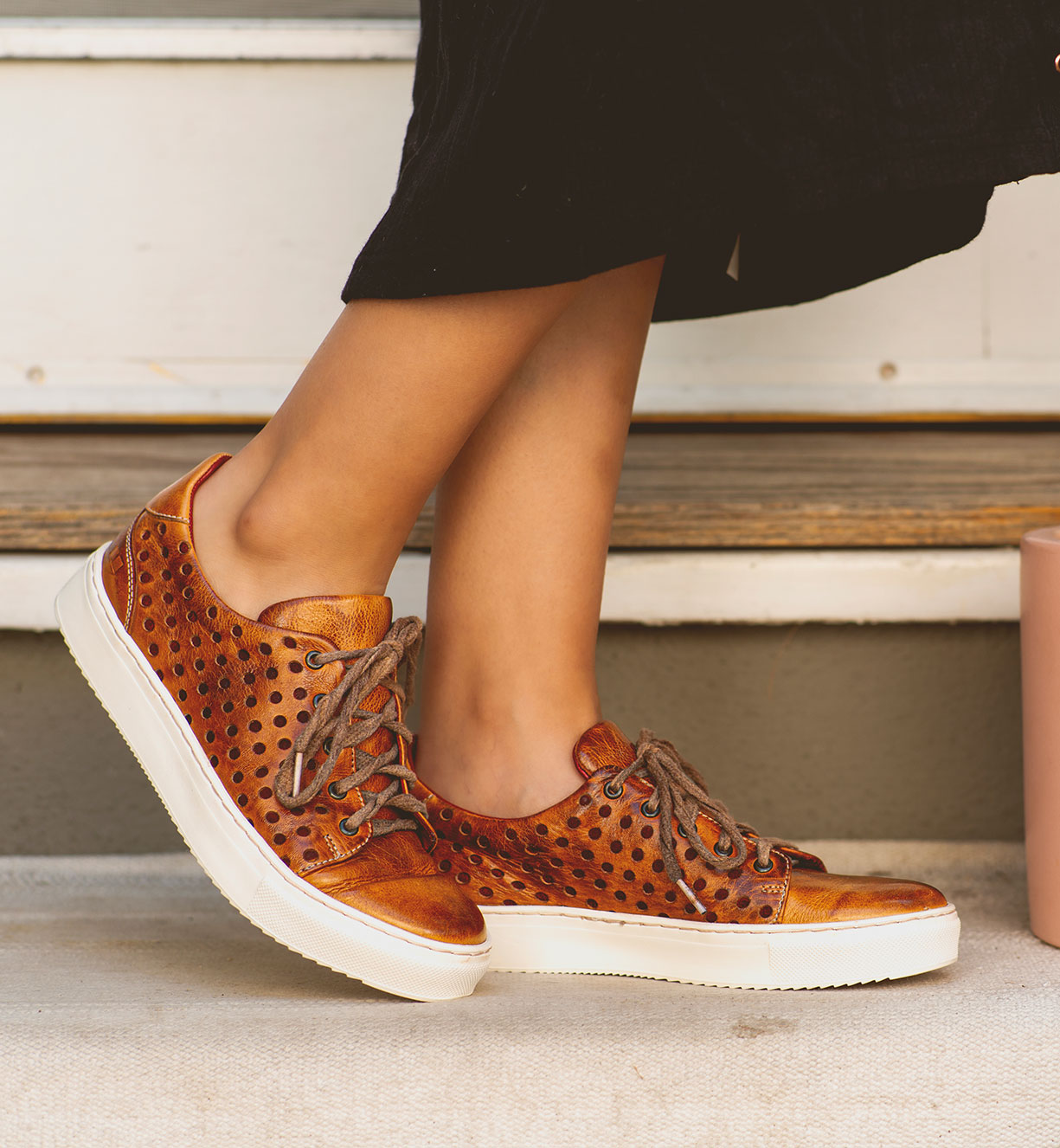 Woman's foot wearing summer style shoes sneakers with laces