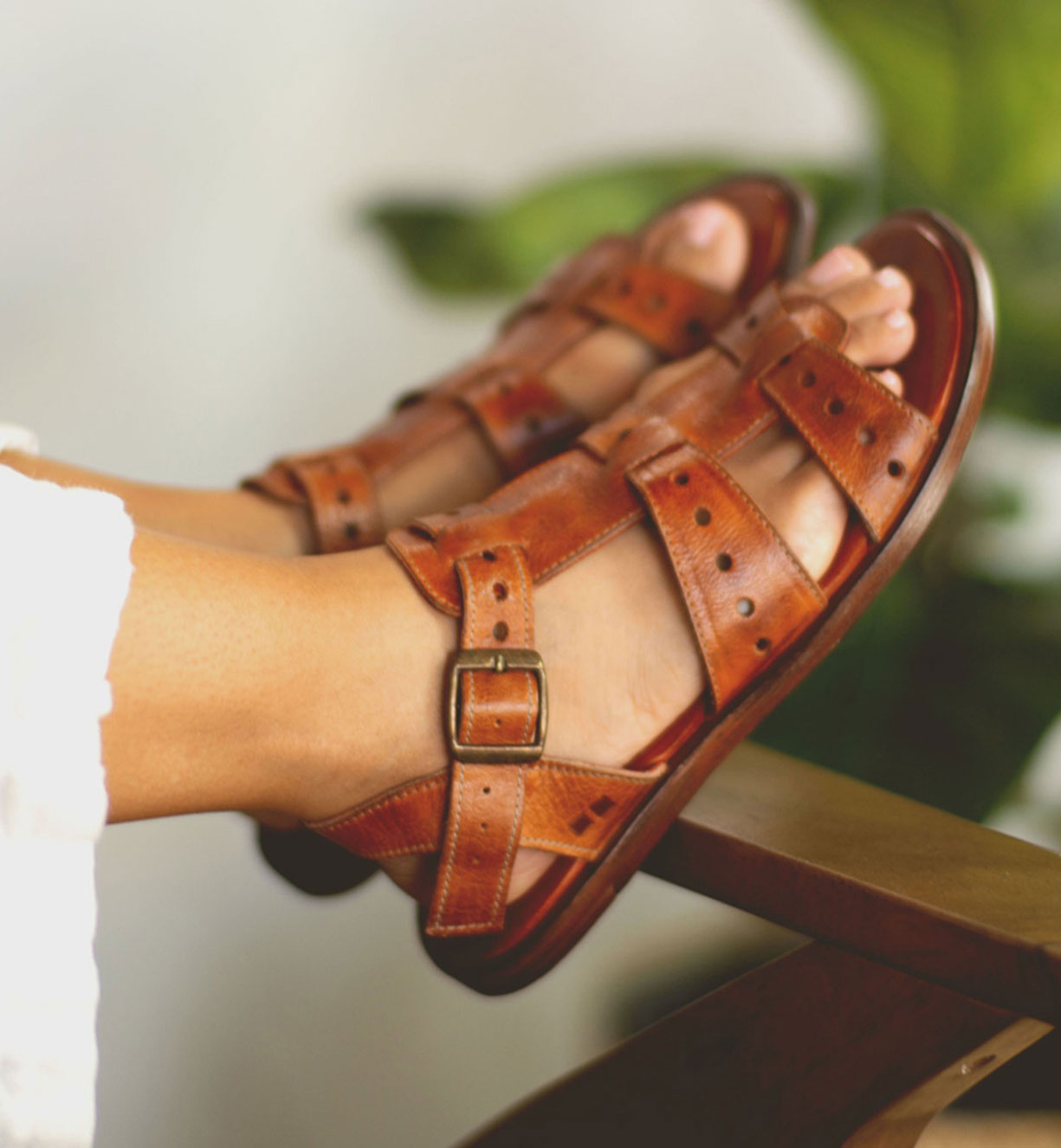 Woman's foot wearing strappy leather sandals Sue