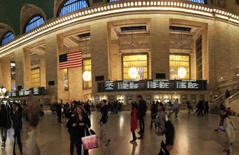 Wide shot of Grand Central Terminal bustling with people in New York City
