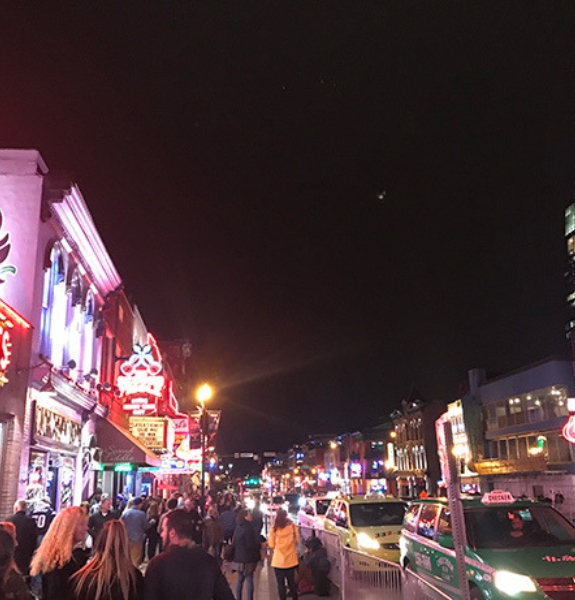 Shot of a bustling street in Honky Tonk Central of downtown Nashville