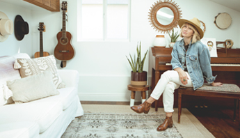 Singer/songwriter Brooke White wearing Bed|Stü's Ellice handmade leather boot in her home music room.