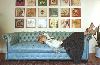 Brooke White wearing Bed|Stü's Filly II handmade leather boot on her thrifted leather couch