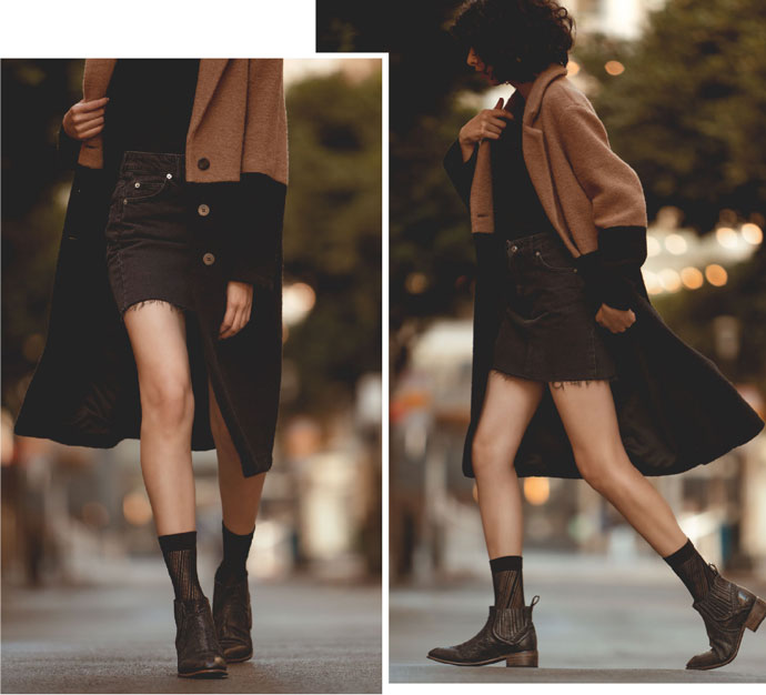 Bed|Stü's handmade leather short boot, Ellice, styled with sheer crew socks, a black denim skirt, and a color blocked wool coat