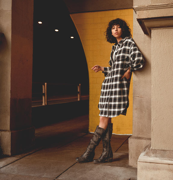 Bed|Stü's handmade leather tall boot, Decree, styled with an oversized plaid coat worn as a dress.