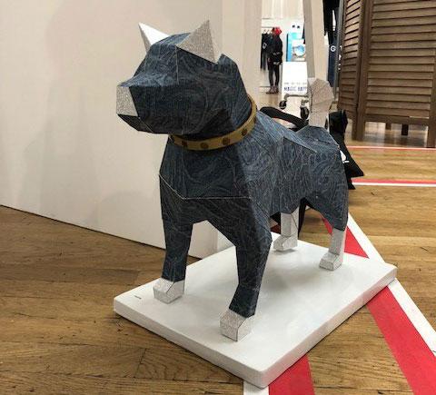 Shot of a dog made out of denim pieces, wearing a Bed Stu leather collar