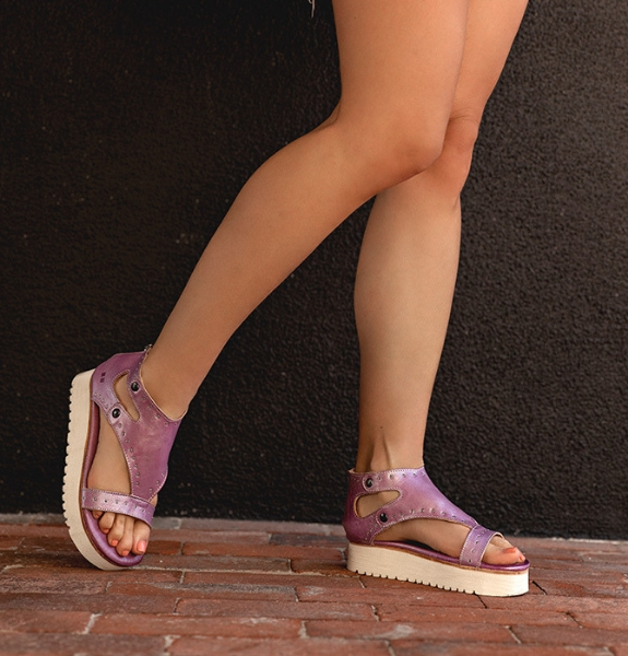 Close shot of woman standing on a brick walkway wearing Bed Stu Soni platform sandals in Lilac Rustic Silver Metallic color