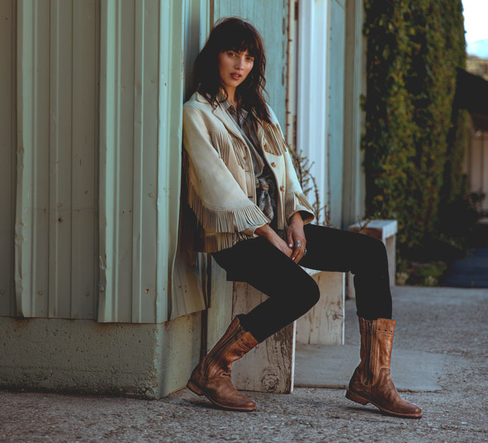 Bed|Stü's handmade leather boot, Venmont in Tan MD, styled with jeans and a white leather jacket.