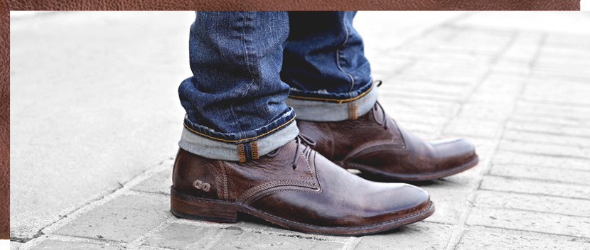 Mens Teak Bradley Boot, a goodyear welted 5 eye plain toe chukka boot side view worn with rolled up denims