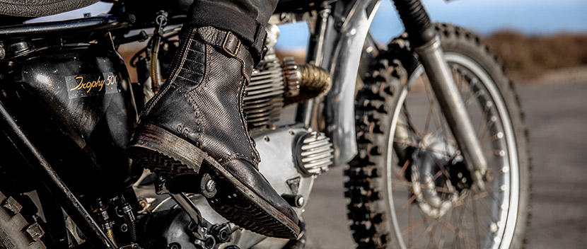 close up of leather boot on the accelerator of a motorcycle