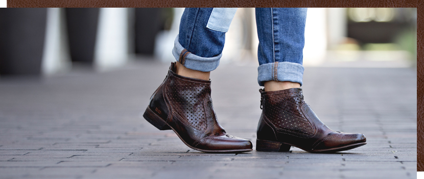 Womens ankle high pointed toe slip dark brown Braynna boot with perfing details on the shaft, worn with rolled up loose denim