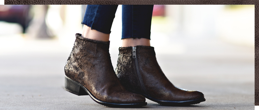 Womens distressed handmade brown short boot with a 1 inch heel worn with ankle cut denim, made in italy